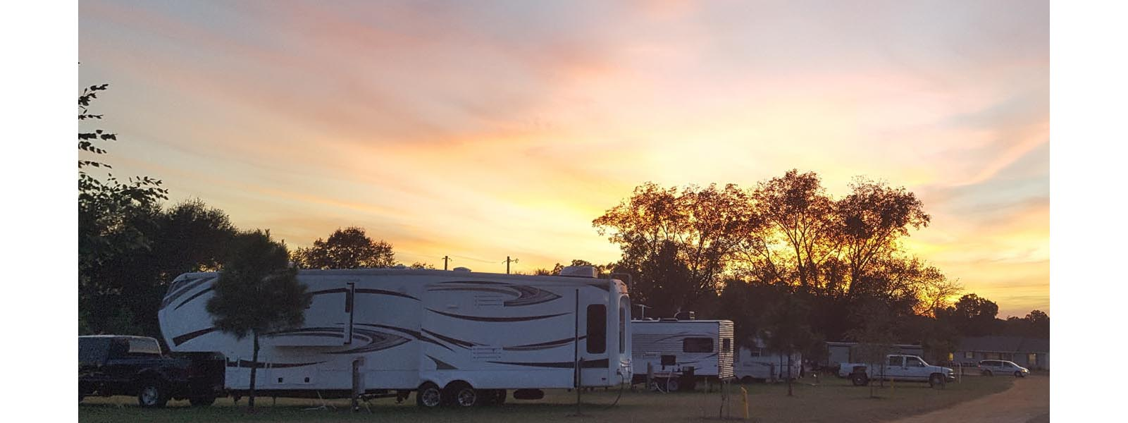 Sunset picture of 5th wheel rvs camping at the campgrounds